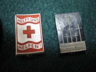 TWO GERMAN PINS ONE RED CROSS THE OTHER HONORING WAR DEAD
